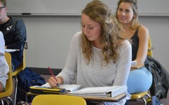Completing an assignment, senior Jan Gagstetter studies in her AP Statistics class.