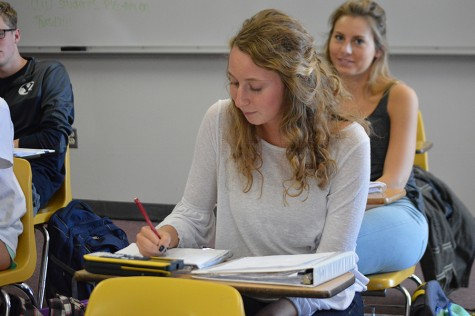 Completing an assignment, senior Jan Gagstetter studies in her AP Statistics class.