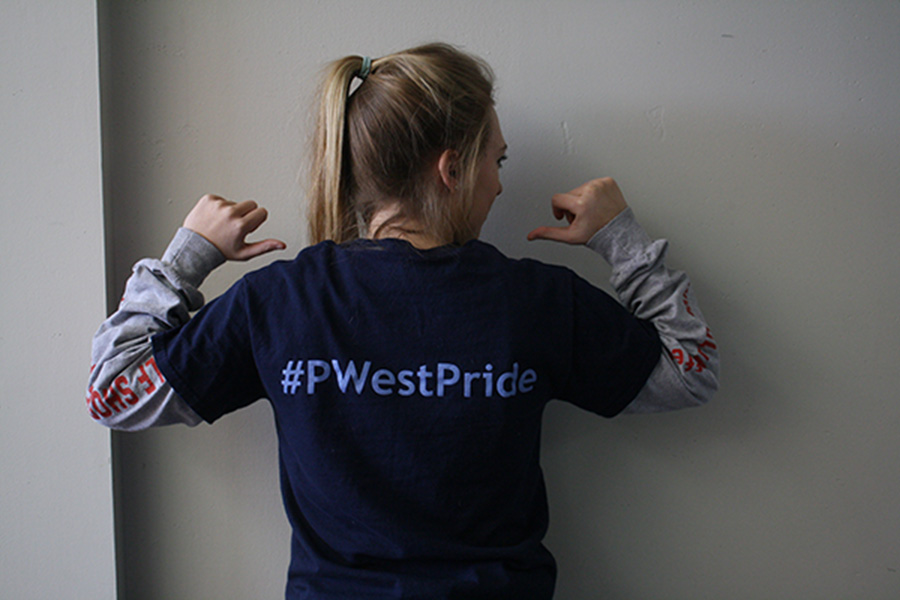Sophomore Ashley Avery poses with the newest shirt that includes universal hashtag #PWestPride on the back.