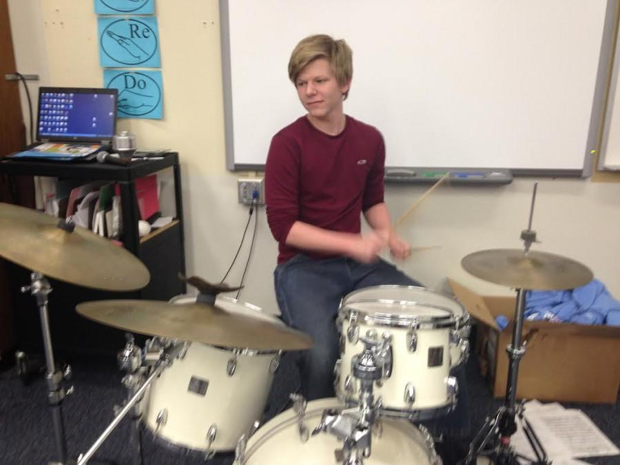 Junior+CJ+Schrieber+plays+the+drum+set+for+his+jazz+band%2C+Cosmic+Latte.+Schrieber+has+played+drum+set+in+West+High+marching+band+shows+since+his+freshman+year.+%E2%80%9CI%E2%80%99m+going+to+try+to+write+more+concert+band+things+that+are+less+percussion-oriented%2C%E2%80%9D+Schrieber+said+about+his+percussion-centered+compositions.