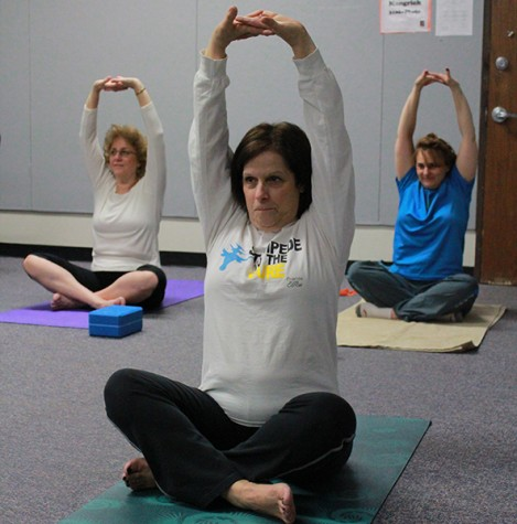 Faculty participate in after school yoga classes
