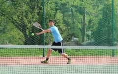 Returning the ball, senior William Tong competes in his match against Rockwood Summit last year.