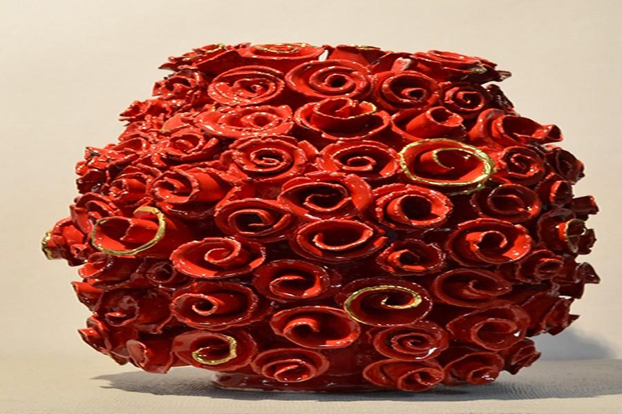 Junior+Zarah+Habibollah+creates+a+rose-covered+coil+pot+for+Ceramics+class.