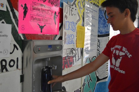 Filling his water bottle before track practice, sophomore Grant Aden dares to drink the red-filtered water. Aden brings his reusable water bottle to school every day.