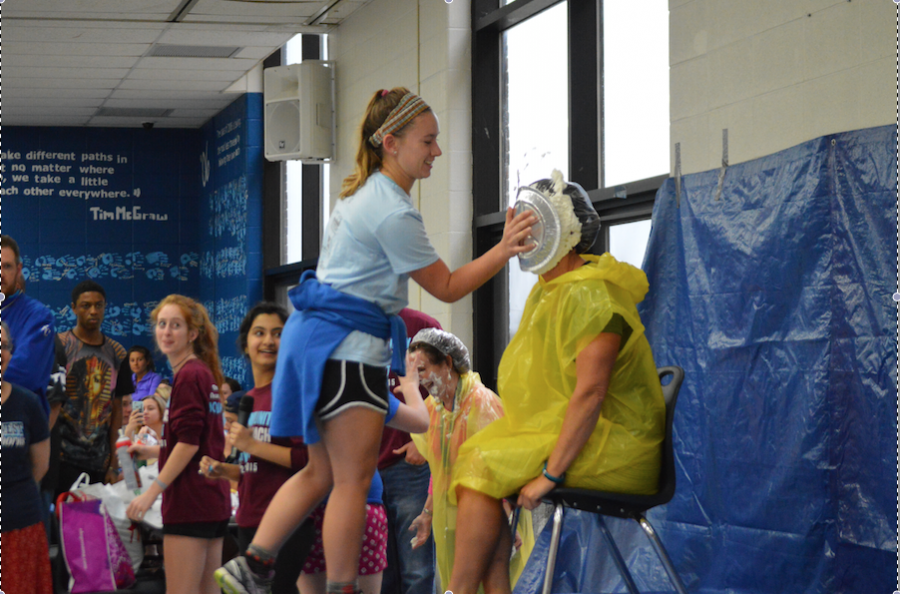 Junior Emily Wind pies Kristen Collins for Cash for Cancer.