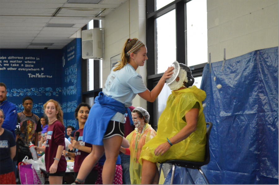 Junior Emily Wind pies Kristen Collins in the face for Cash for Cancer.