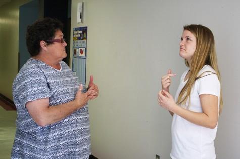 Junior Rachel Ebner signs with her interpreter, Kathy LaBoo before history class.