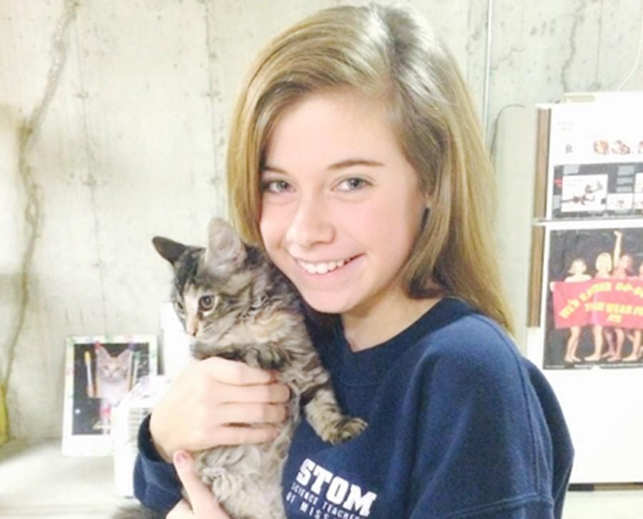 Freshman Kennedy Silverberg holds her cat Pixie.