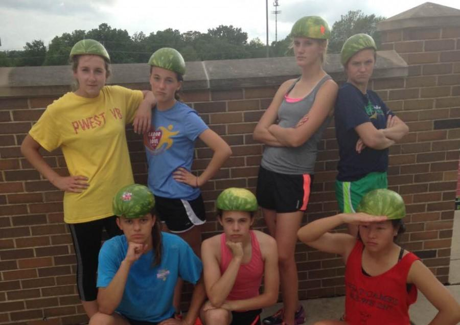 Girls+Track+poses+for+a+picture+after+the+run+with+the+watermelon+rind+on+their+heads.