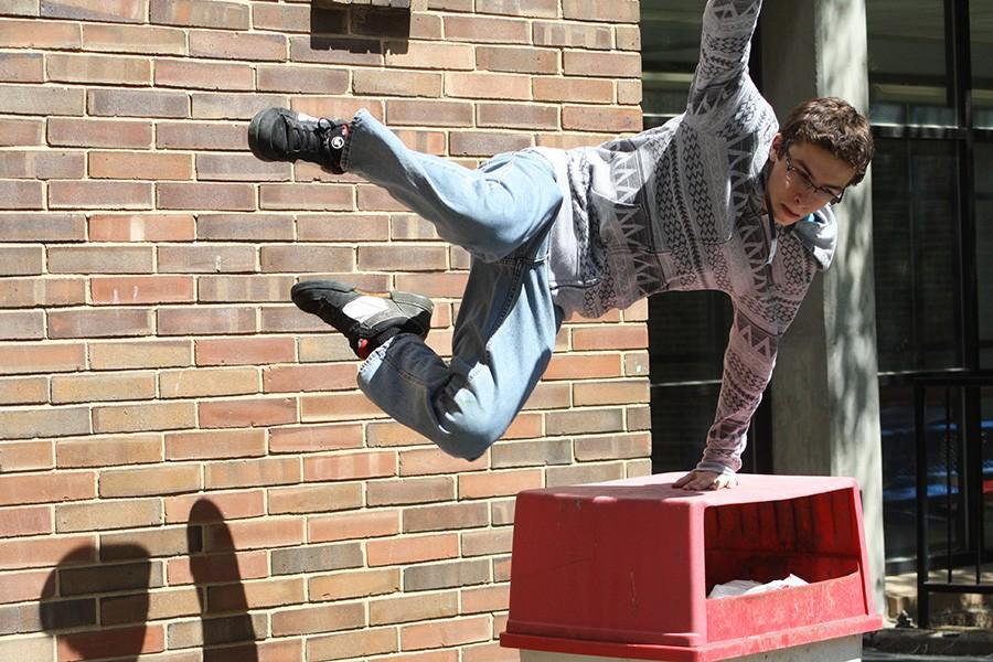 Sophomore Austin Valenti practices his parkour stunts outside.