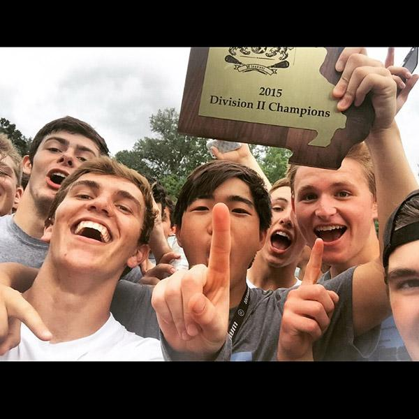 Seniors+Jack+Synder+and+Alex+Karrenbrock+posed+with+graduates+Jon+Roh+and+Matt+Hall+after+winning+the+D2+2015+lacrosse+state+championship.+