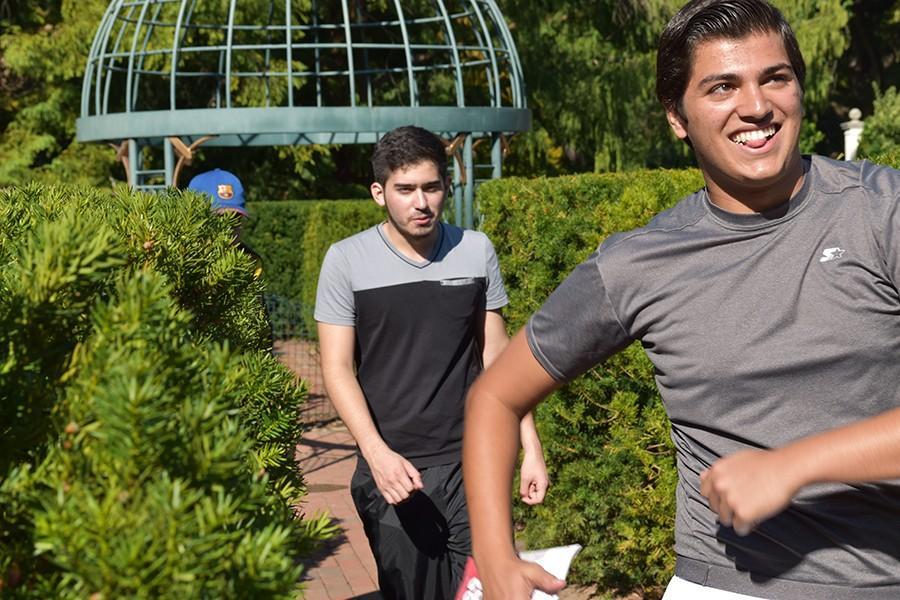 Walking+through+a+maze%2C+senior+Milan+Malholtra+and+Prepa+Tec+student+Arturo+Jimenez+find+their+way+through+at+the+Botanical+Gardens+on+Wednesday%2C+Sept.+24.