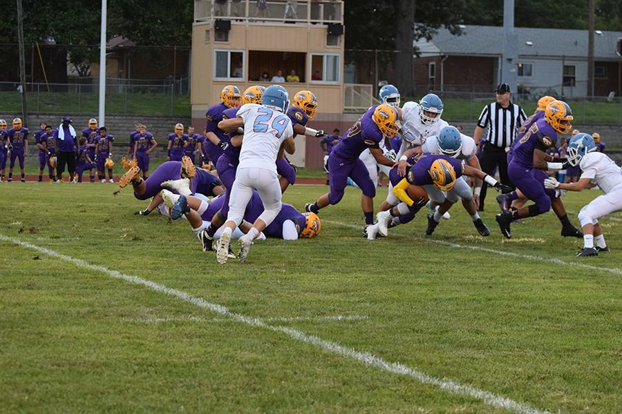 The Longhorn defense stops Afton during their game on Aug. 28.