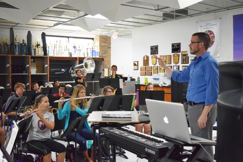 Mr. Wallace conducts the Parkway West High Marching Band in preparation for a Friday night football game.