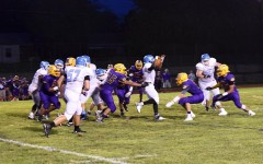 Senior running back Nick Lewis sheds off a defender on the way to upsetting the number five ranked Affton Cougars.