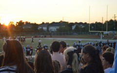Varsity football fans attend the boy's first home game against U. City on Sept. 11.