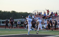 Junior Antonio Smith and Senior Simon Lindo celebrate senior Bobby Connor's pass completion for a big gain.