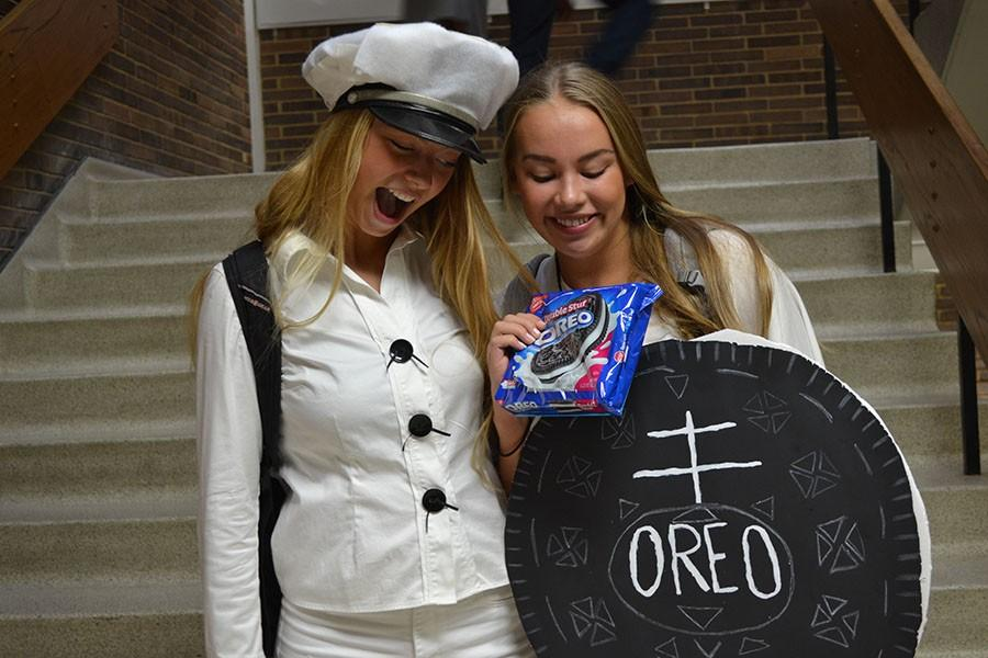 Seniors+Audrey+Frost+and+Anna+Worpvik+participate+in+homecoming+week+by+dressing+up+as+the+cookie+and+the+baker.+