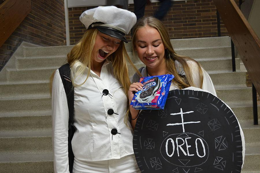 Seniors Audrey Frost and Anna Worpvik participate in homecoming week by dressing up as the cookie and the baker.