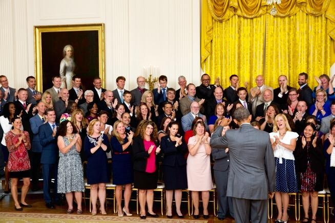 Awardees standing on risers applaud as President Obama enters the room. There were 108 awardees this year, all teachers of secondary math or science classes.