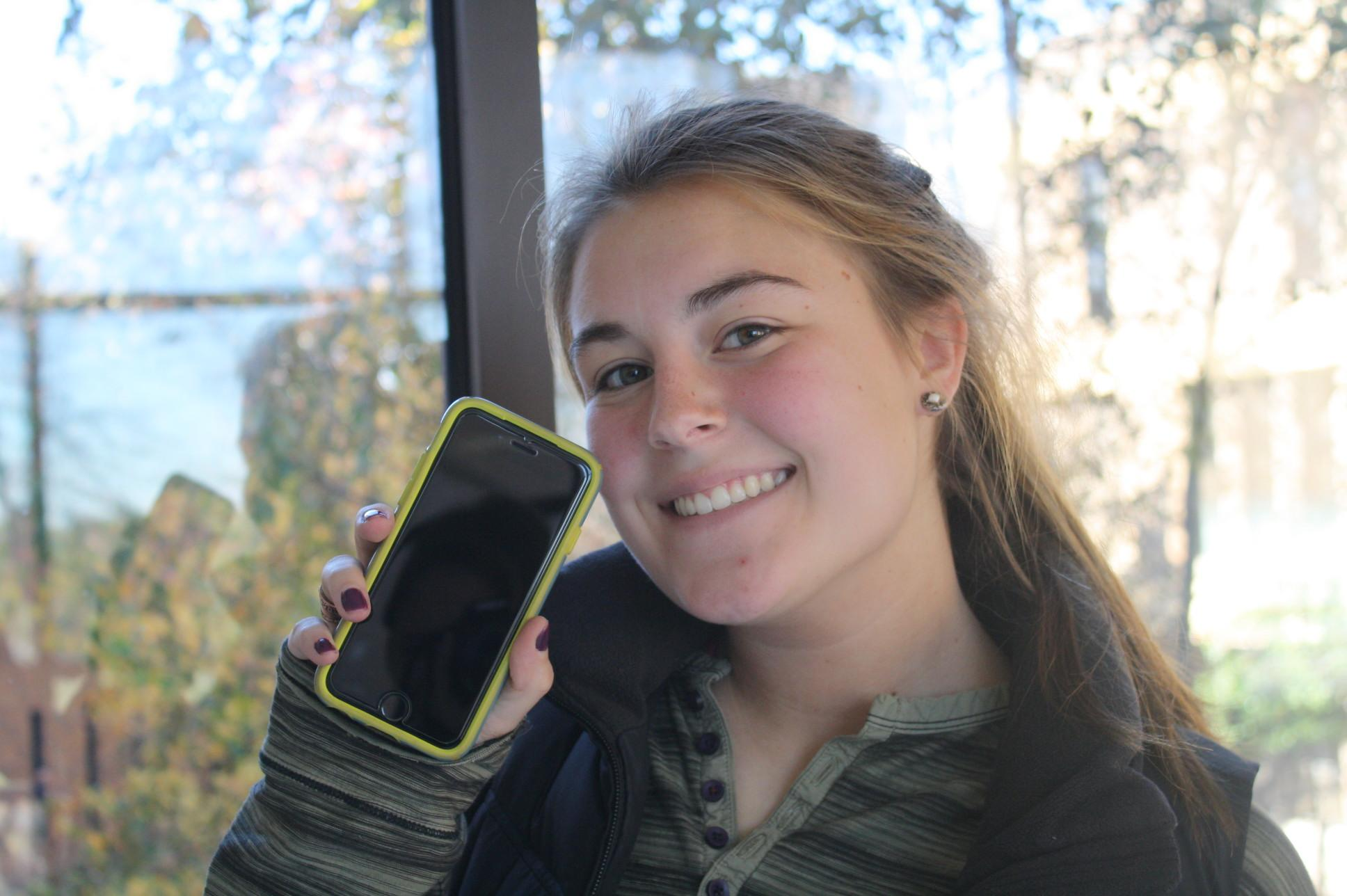 Maddie Rose holds up her new iPhone 6S.