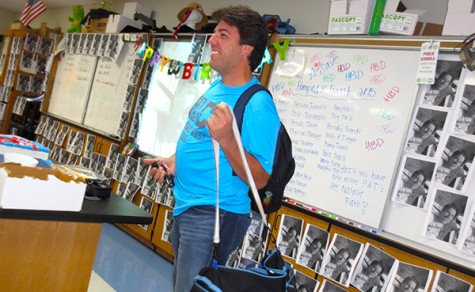 Grace Miller and her cross country team threw a party for Cutelli's birthday in his classroom by filling his room with four hundred and fifty embarrassing photos of him on Oct. 15. [Rachel Ebner]
