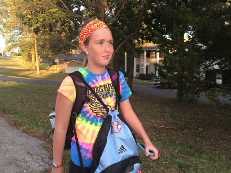 Sophomore cross country runner Jane Fuller walks home with the new girls cross country backpack, which features the redesigned