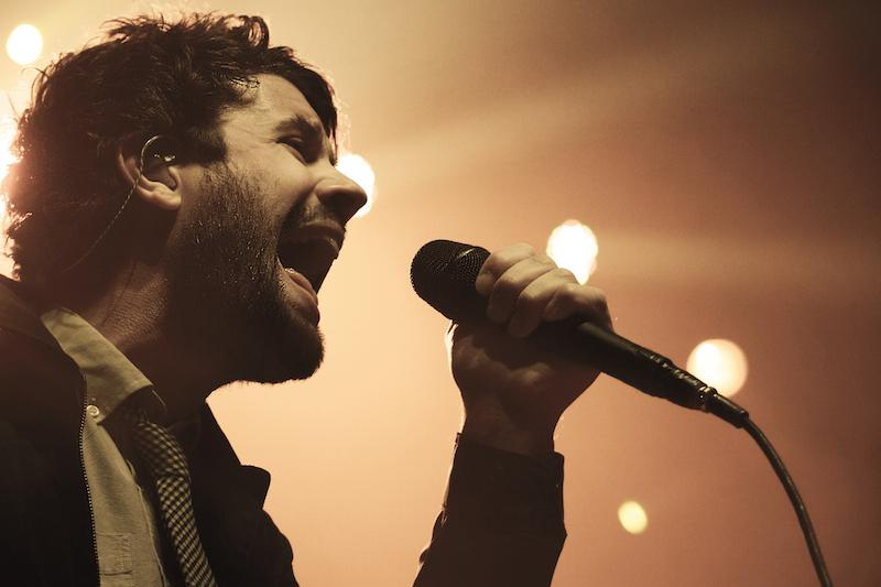 Michael+Angelakos+belts+out+his+opening+song+%22Secrets%22.