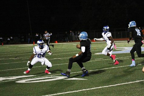 Senior running back Nick Lewis shakes off a defender against Ladue on Oct. 2 at home.
