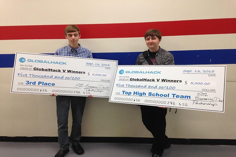 Seniors Samuel Wait and Matt Sauer hold their oversized $5,000 checks from Globalhack V.