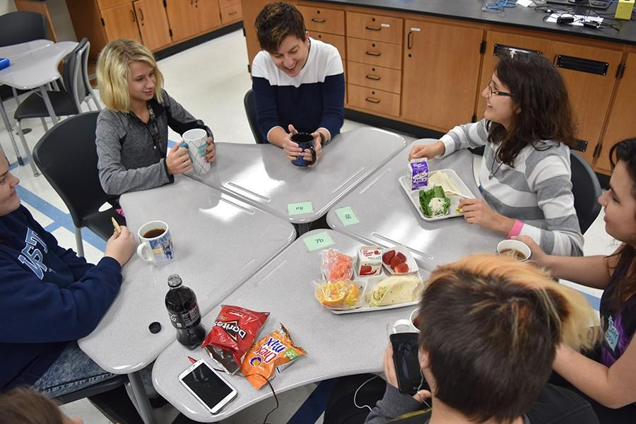 Students at the Tea Time meeting for first lunch discuss the new Star Wars movie coming out with science teacher and creator of the holiday, Amy Van Matre-Woodward.