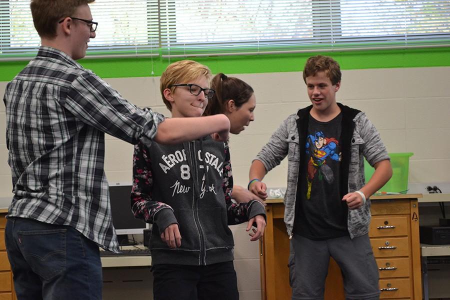 Creating physical humor in a group scene, senior Cara Crowley, junior Duncan McBride, freshmen Derek Isele and Hayden Riehl participate in practice in preparation for their show on Dec. 11.