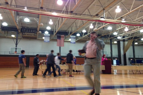 Math teacher Patrick Mooney rushes results and awards to the students after the test.