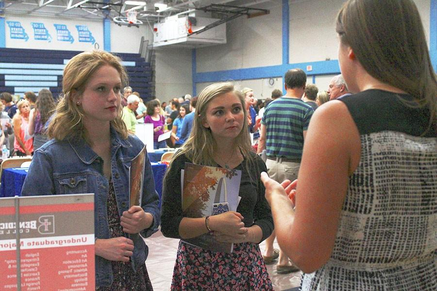 Seniors+Syndey+Baker+and+Kathryn+Harter+attend+the+college+fair+held+in+the+Parkway+West+Gymnasium+on+Sept.+15.+