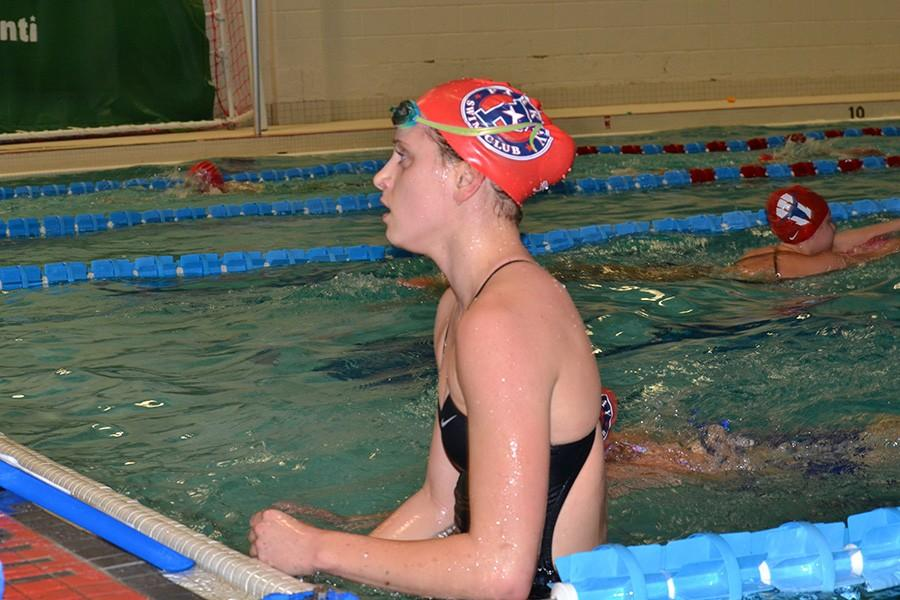 Girls swim team members discuss new team bonding traditions