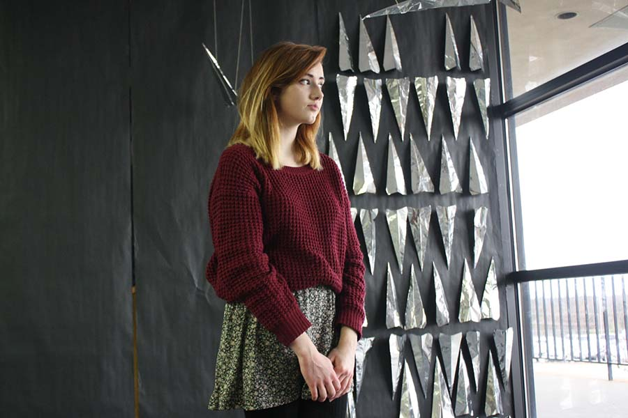 Junior Remi Aalfs models a Forever 21 sweater and skirt.