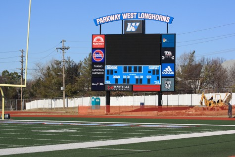 The new scoreboard is adorned with advertisements to pay for the $400,000 scoreboard.