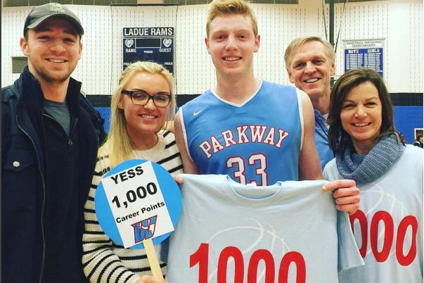 Junior+Wyatt+Yess+celebrates+with+his+family+after+he+scored+his+1000th+point+at+the+Varsity+basketball+game+against+Ladue.