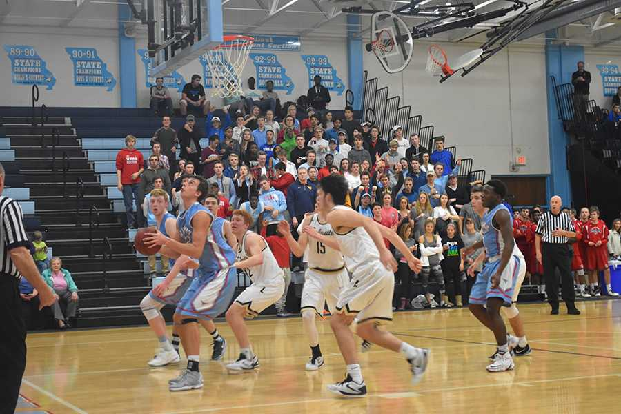 Senior Nick Lathrop grabs a rebound against Lafayette in the annual Parkway West tournament.
