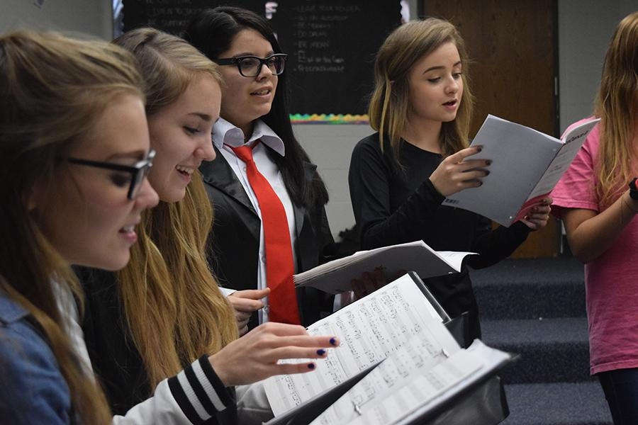 Jazz Choir students senior Sidney Baker,  juniors Caroline Vogl and Grace Glennon and senior Jessica Novik rehearse in the choir room.