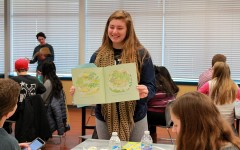 Reading from a picture book, senior Andrea Gordon presents the lesson to her group.