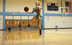 Going in for a layup, freshman Tess Allgeyer makes the shot.