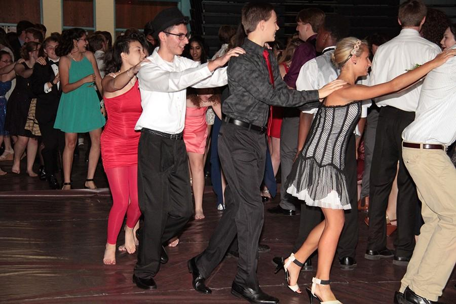 Students at this year's homecoming dance parade around the room in a conga line.