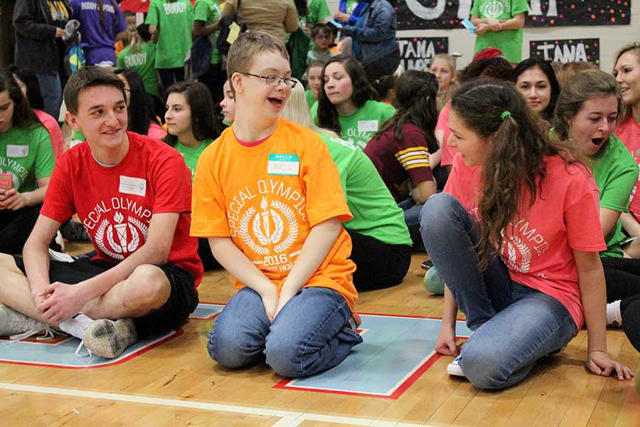 Junior Chris Williams and sophomore Sophia Malpocker hang out with their Special Olympics buddy.