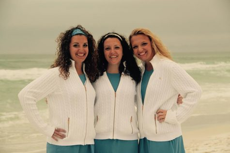 B. Kottmeyer poses with her two triplet sisters.