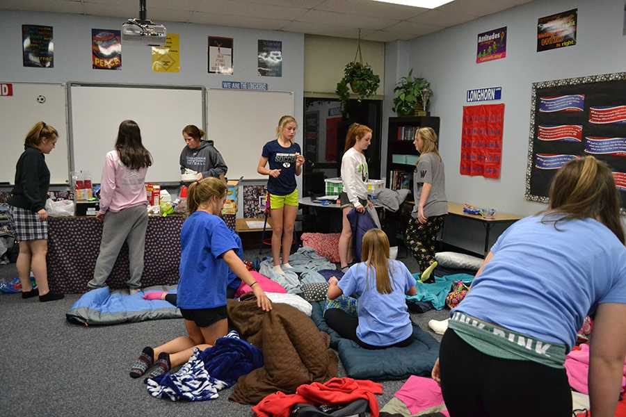 Every year before the season begins, the girls varsity soccer team spends the night in head coach Annie Waylands room as a way to bond before the games start.
