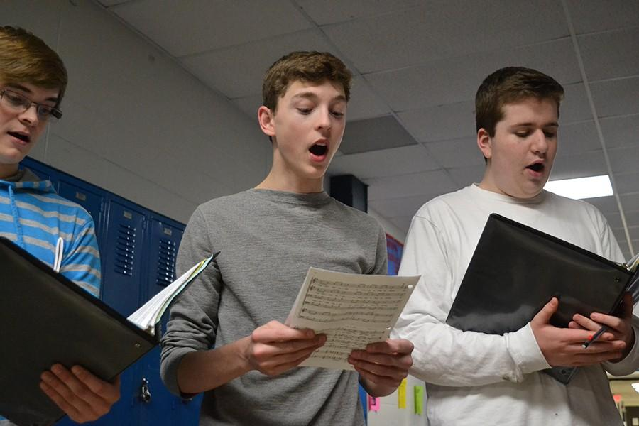 Tenor twos senior Marc Doughter, juniors Alex Dunn and Josh Gorman practice an arrangement of the traditional tavern song