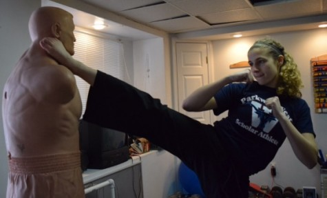 Angie Sanfilippo kicks a practice dummy.