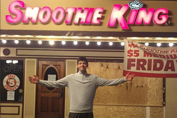 Sophomore Andrew Eickmann stands in front of the Manchester Smoothie King after the accident on Dec. 29, 2015.