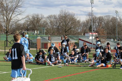 The boys lacrosse team huddles together after the first half versus Chaminade to discuss what to work on to beat the opponent.